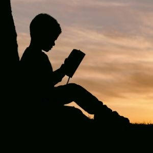Boy reads Bible